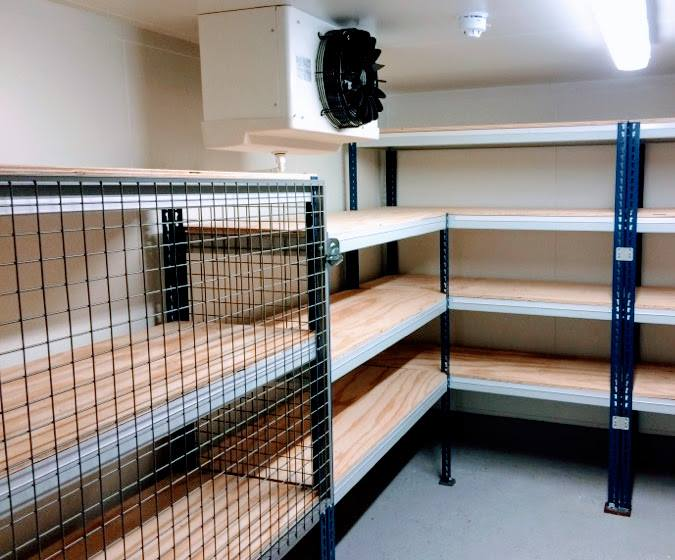 Boltless steel shelving with mesh partioning to add secure compartments